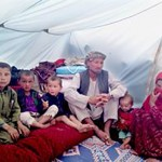 Mehrabudin and his surviving children in temporary shelter after the landslide Photo: ACT/CWS-PA