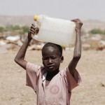 A Sudanese refugee boy carrying water in Treguine refugee camp on the World Water Day March 22, 2012.