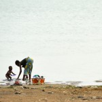 A woman and her child washing dishes in the Niger River at Segou, Mali. Photo by Paul Jeffrey for the ACT Alliance.