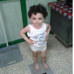 A refugee child being weighed at the Well Child Clinic in Cairo.  Photo: Refuge Egypt