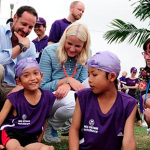 Norwegian H.R.H. Crown Prince Haakon and H.R.H Crown Princess Mette-Marit meet students at Huong Toan Primary School while they're having a swim class. Photo: Pham Van Ty/NCA Vietnam