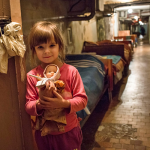 Anna, 3, and her family have been sheltering in this hospital basement for the past five months following an upsurge of fighting in the Ukrainian city of Donetsk. A two-year conflict in Ukraine has displaced 1.5 million people, nearly 180,000 of which are children. IOCC is responding with emergency food assistance for infants and toddlers severely impacted by the conflict. Credit: UNICEF