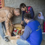 The Qasm family inspects the food box given to them by LWF. A ration for 15 days contains 10 kg of rice, lentils, salt, tea, beans, caned vegetables and chicken meat, sugar, pasta, bulgur and four bottles of cooking oil. It is supposed to last for 15 days. 