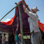 Locals in Byasi Tole, come togehter to build a temporary shed for the people in Byasi Tole, who have lost their homes following the earthquake. Photo: ACT/DCA/Shikhar Bhattarai