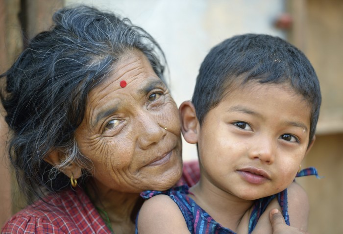 Hari Maya Bhujel hugs her grandson, 5-year old Utsab, in Majhitar, a village in the Dhading District of Nepal where Dan Church Aid, a member of the ACT Alliance, has provided a variety of support to local villagers in the wake of a devastating 2015 earthquake. Parental consent obtained. Photo: Paul Jeffrey