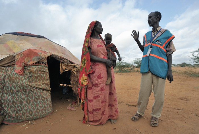Mohammed Haibe (right) is a Community Peace and Security Team member in the Ifo Camp, part of the Dadaab refugee complex in northeastern Kenya. here he talks with Faduma Absher Tuko. The CPSTs, coordinated by the ACT Alliance, provide self-policing in the camps. They team members are all refugees and volunteers. The Lutheran World Federation, a member of the ACT Alliance, is camp manager for the Dadaab complex, essentially the world's largest refugee camp. Photo: Paul Jeffrey