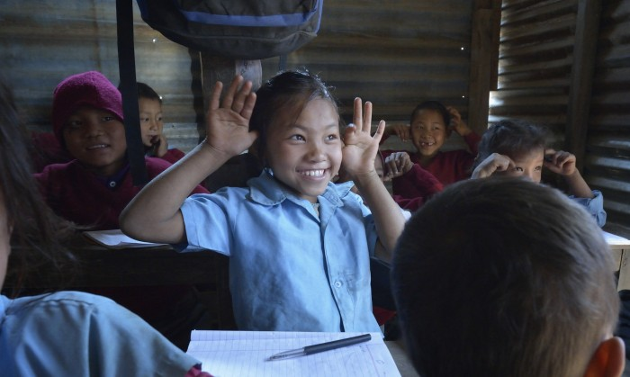 Children sing a song in class at the Shri Pashupati Praja Primary School in the village of Tanglichowk, in the Gorkha District of Nepal. Photo: Paul Jeffrey