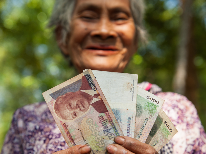 """'I plan to use this grant money to buy a sack of rice for my family,"""" said Lim Ean (79), from Cambodia. ACT members provide CASH transfer in several emergency responses. Photo: Paul Jeffrey"""