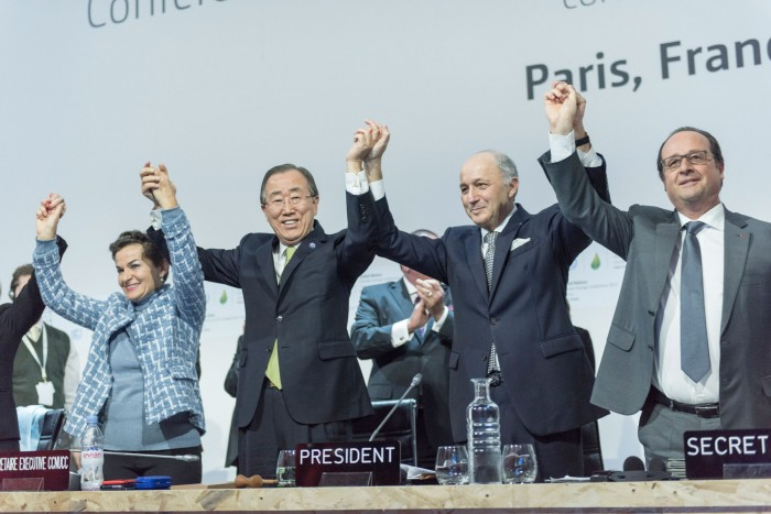 SG delivers remarks at the closing ceremony of COP21. UN Photo/Mark Garten