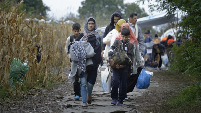 Refugees and migrants on their way to western Europe approach the border into Croatia near the Serbian village of Berkasovo. The ACT Alliance has provided critical support for refugee and migrant families here and in other places along their journey. Photo: Paul Jeffrey