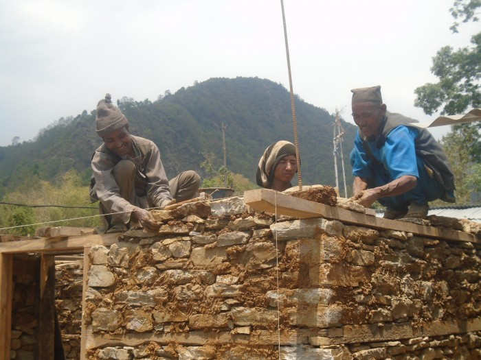 Durgalal support his neighbors to construct a permanent shelter. Durgalal is a professional mason. Credit: LWF Nepal