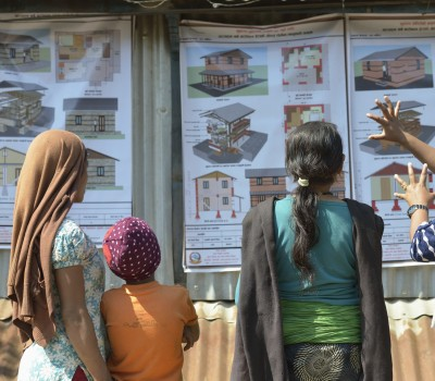 Sapana Lamichhone (right), a pyscho-social volunteer for the ACT Alliance in Makaising, a village in the Gorkha District of Nepal, explains to neighbors the variety of options they have for constructing houses to replace the homes they lost in a devastating 2015 earthquake. Dan Church Aid, a member of the ACT Alliance, has provided a variety of support to local villagers in the wake of the quake, including the training of carpenters and masons who can build the new dwellings once the government disburses funds for their construction.