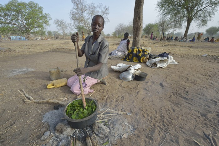 Nidier Atak cooks wild leaves in Rumading, a village in South Sudan's Lol State where more than 5,000 people, displaced by drought and conflict, remain in limbo. Atak and her five children left their home in Wanalel in January 2017 after successive crop failures left them with no other options. They set out walking for Sudan, seeking better conditions, but stopped at Rumading when they met others who had been violently turned back at the border. So they remain camped out under trees, eating wild leaves as the rainy season approaches. Her husband had left home looking for work months earlier, and she doesn't know where he is. In early April, Norwegian Church Aid, a member of the ACT Alliance, began drilling a well in the informal settlement and distributed sorghum, beans and cooking oil to the most vulnerable families. It is carrying out the emergency assistance in coordination with government officials and the local Catholic parish. South Sudan