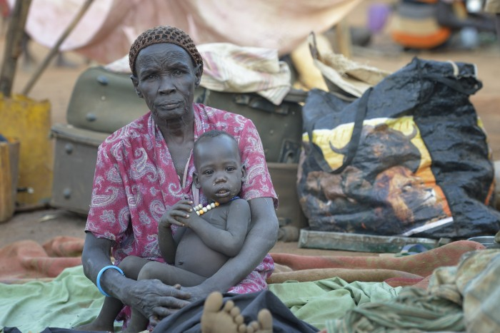 Angelina Awen sits with her granddaughter Aok in a camp for over 5,000 internally displaced persons in an Episcopal Church compound in Wau, South Sudan. Most of the families here were displaced by violence early in 2017, after a larger number took refuge in other church sites when widespread armed conflict engulfed Wau in June 2016. As the rainy season approaches, they have no shelter, and sleep every night in the open. Norwegian Church Aid, a member of the ACT Alliance, has provided relief supplies to the displaced in Wau, and has supported the South Sudan Council of Churches as it has struggled to mediate the conflict in Wau. South Sudan