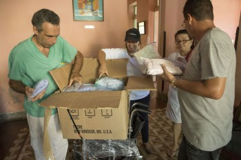 Relief supplies being unpacked at a nursing home in Cuba.  The ACT Cuba Forum is providing relief to vulnerable people, including seniors and children, affected by Hurricane Irma.  Photo: Erick Coll/ACT