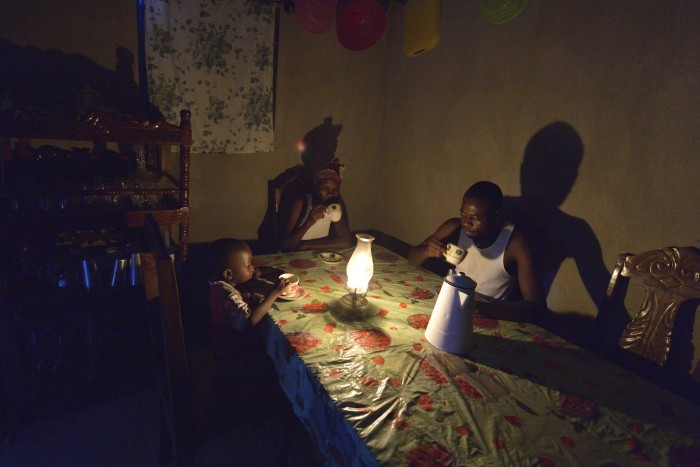 Eliciore Volbrun (center) and her sons Youri (left) and Wilson drink tea before dawn in their family's new home in Djondgon, a village near Jean-Rabel in northwestern Haiti. The family's previous house was destroyed during Hurricane Matthew in 2016, and Church World Service, a member of the ACT Alliance, helped the family build their sturdy new home. Photo: Paul Jeffrey