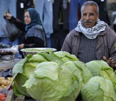 A man selling cabbages in the market of the Nuseirat refugee camp in the middle of the Gaza strip. Photo: Paul Jeffrey/ACT