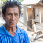 Mr. Mushki is a fisherman from Pantolowan village near Palu, Indonesia. He was out fishing when the earthquake struck, and the resulting tidal wave tossed him and his boat ashore, knocking him out and destroying the boat. ACT member Pelkesi's mobile clinic helps with treatment for his injuries. He hopes to get back to fishing again, as it is what he has done his whole life. Photo: Simon Chambers/ACT