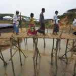 Rohingya refugees crossing bridge