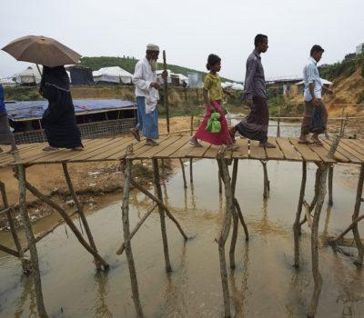 Rohingya refugees crossing bridge