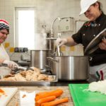 Cooking in the communal kitchen - young people take responsibility and care for themselves and others in a programme for unaccompanied minors seeking asylum in Austria. Photo: Nadja Meister / Diakonie Flüchtlingsdienst