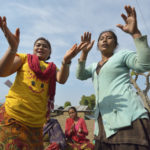 Women dance during the gathering of an emotional support group in Makaising, a village in the Gorkha District of Nepal where Dan Church Aid, a member of the ACT Alliance, has provided a variety of support to local villagers in the wake of a devastating 2015 earthquake. ACT Alliance psycho-social workers have helped villagers recover from the quake both physically and emotionally. Photo: Paul Jeffrey/ACT