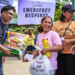 NCCP- ACT Alliance volunteers from local churches give food relief packs to affected families. 135 families received emergency assistance. Photo: Noe Cenal/ACT Philippines Forum
