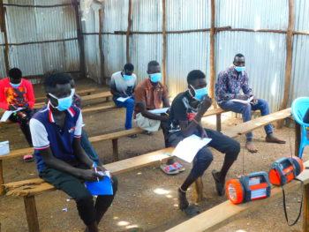 Grade 8 students participating in a class by radio in Kenya, supported by FCA. Photo: FCA